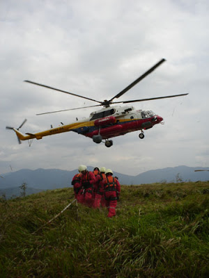 One of Bomba Mi-17s conducting a rescue exercise with ground troops.