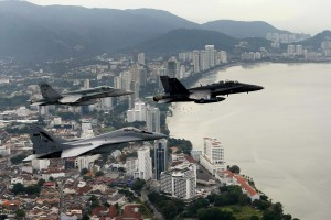 A formation containing a Malaysian F/A-18D Hornet, a MIG 29 and an Australian F/A 18 Hornet fly over the Penang region of Malaysia, the flight was organized as a prelude flight to Bersama Lima 2011.