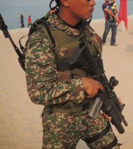 A paratrooper with an M4 Carbine with sights and grenade launcher.
