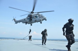 RMAF Airbus Helicopter H225M Cougar delivering SF soldiers during an exercise on the South China Sea in 2014. Joint Force picture.