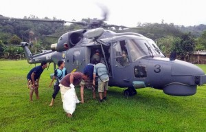 Super Lynx M502-03 sending food items to one of the areas affected by floods in December 2015. TLDM picture.