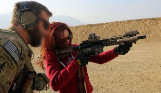 An U.S. Special Forces soldier, attached to Combined Joint Special Operations Task Force-Afghanistan, teaches a Washington Redskins cheerleader the functions of a M4 Carbine while at a range near Kabul province, Afghanistan, Jan. 24, 2014. The cheerleaders visited soldiers as part of their military appreciation tour. (U.S. Army photo by Spc. Connor Mendez/Released)