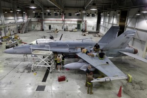Avionics personnel from No. 75 Squadron RAAF work late into the night at their base in the Middle East to get an F/A-18A Hornet ready for its next mission over Iraq. Australian MOD