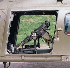 Two GPMGs mounted in the cabin of an AW109
