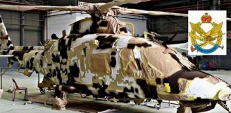 PUTD AW109 being painted in desert camouflage. Air Times picture
