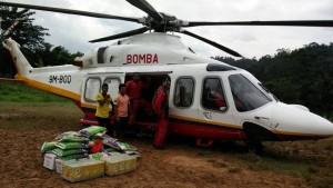 Bomba AW139 9M-BOD carrying supplies to an Orang Asli village during the massive floods in late 2014. Bomba picture.