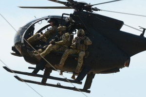 A US MH-6 Little Bird carrying operators on a rig designed to carry personnel. US Army picture