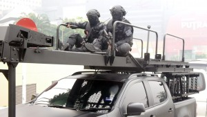 UTK operators sitting on top of the assault ladder of their Hilux.