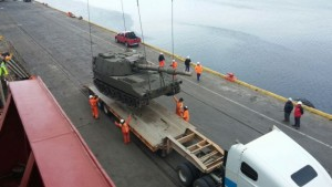 A M109-A5 howitzer is offloaded and craned onto a trailer at the port in Punta Arenas, Chile, in December, 2014. The self-propelled howitzer was one of 12 purchased by the Chilean army through the U.S. Army Security Assistance Command's foreign military sales program.