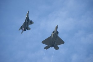 Mig-29N M43-03 flies together with a USAF F-22 Raptor at Cope Taufan 2014. 03 is one of the most pictured Fulcrum instantly reconigsable for its colourful fins simbolising the 17th Squadron,