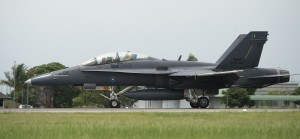 A Royal Malaysian Air Force (RMAF) F/A-18D M45-02 Hornet aircraft lands at RMAF base Butterworth, Malaysia, June 11, 2014, during Cope Taufan 2014.  Note the bomb markings on the nose. U.S. Air Force photo.