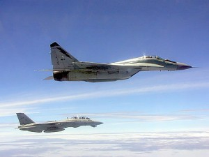 RMAF Mig-29N Fulcrum flies with a US Navy Tomcat. US Navy.