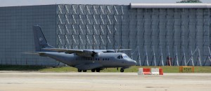RMAF CN235 M44-05 taxis past one of the new hangars built at Subang specifically for the A400M. This hangar is built for the maintenance of the Atlas.