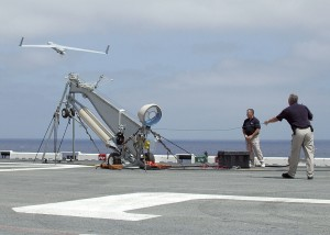 A Scan Eagle launches from a pneumatic wedge catapult launcher on the flight deck aboard the amphibious assault ship USS Saipan. US Navy picture.