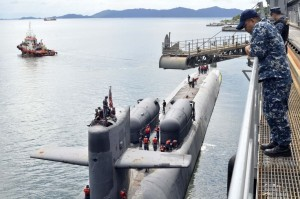 Chief Engineman Bernard Paje watches as guided missile submarine USS Ohio (SSGN 726) gets underway after being moored alongside submarine tender USS Emory S.Land (AS 39 ), at RMN Kota Kinabalu naval base on Teluk Sepanggar. US Navy.