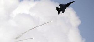 RSAF Strike Eagle firing flares as part of its display routine.