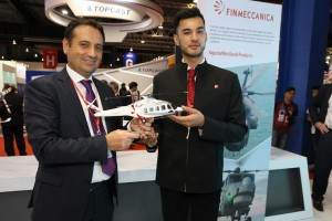 A Finmeccanica offcial with presenting a model of the AW189 to a TPG Aeronautik official. Finmeccanica.