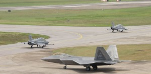 Two Royal Malaysian Air Force BAE Hawk and an F-22 Raptor from Hawaii National Guard 199th Fighter Squadron and U.S. Air Forces 19th FS taxis during Cope Taufan 2014, P.U. Butterworth, Malaysia June 11, 2014.  USAF picture
