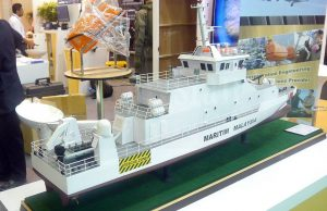 An aft view of the NGPC model at Destini Bhd booth. The upper deck where the two guns are located will also be used to fix the next to recover the Fulmar UAS.