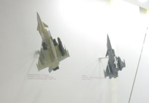Models of the Eurofighter Typhoon and Dassault Rafale with weapons at the MBDA booth