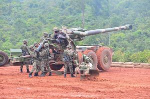 The crew of a G5 155mm howitzer prepping the gun for firing.
