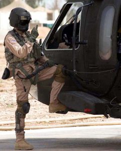 A US Army Blackhawk crew chief with his personal protection equipment including Maxillofacial Shield. US Army photo