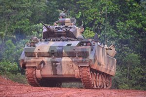 An Adnan ACV with 25mm Bushmaster turret at the firing exercise. Army picture