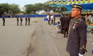 A newly minted RMAF pilot waits for his turn to get into the parade as his colleague is presented his wings.
