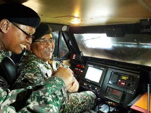 Deputy Minister Datuk Johari Baharum pictured inside the cabin of a MLRS launcher vehicle. This is the first public picture of the inside of  a MRLS vehicle. Kementerian Pertahanan picture.