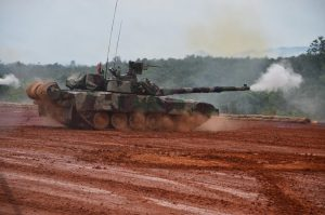 A Pendekar MBT firing its main gun during rehearsals on Tuesday. Army picture