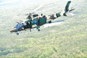 Najib firing the mini-gun from the PUTD AW109 helicopter. H20 Comms picture