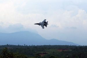 An Su-30MKM Flanker conducting a fly-past after conducting its bombing run. The aircraft was flying around 500 ft AGL when this picture was taken.