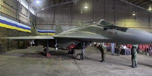 Fulcrum M43-18 - with its green camo was parked inside a hangar used as a VIP holding room.