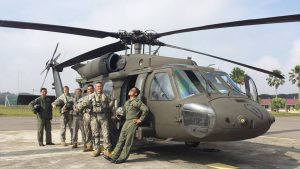 Army Air Wing and US Army pilots and crew posed for a photo with a Blackhawk helicopter. US Army picture.