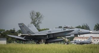 A Royal Malaysian Air Force F/A -18 D Hornet with the 18th Squadron, lands after training scenario during Cope Taufan 16, at Butterworth Air Base, Malaysia July 22, 2016.