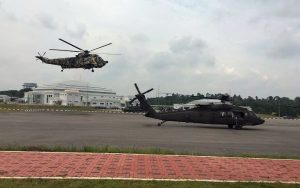 PUTD Nuri helicopter lands next to a US Army Blackhawk during Keris Strike 2016. US Army picture
