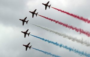 Red Arrows in a perfect formation with the red, white and red smoke