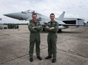 Officer Commanding 1(F) Sqn, Wing Commander Mike Sutton (left) and RAF Lossiemouth's Station Commander, Group Captain Paul Godfrey (right) stood in front of a Typhoon while taking part in Ex Bersama Lima 16. Crown Copyright