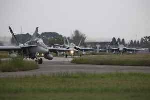 """""""Highway to the danger zone"""". Three Royal Australian Air Force 77 Squadron F/A-18A Hornets taxi towards the take off area at Royal Malaysian Air Force Base Butterworth during Exercise Bersama Lima 16. CA"""